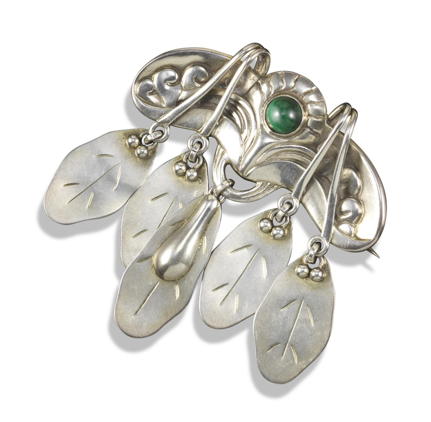 e1ffeb5258 A malachite and silver foliate brooch by Georg Jensen, design no. 14,  c.1904-1908. Estimate £400-600 as part of the October 31 Shannon collection  sale at ...