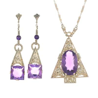 Lot 526: Theodor Fahrner: an early 20th century silver amethyst and marcasite pendant and earrings – estimate £450-650