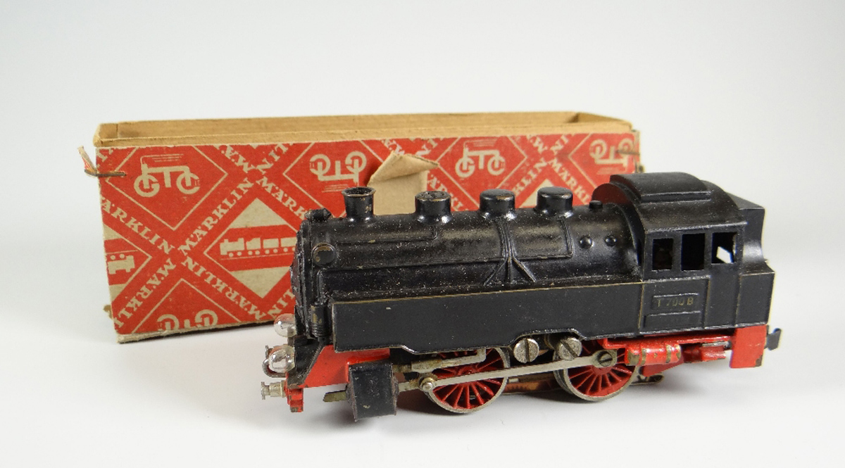 Small model trains steam away to huge prices at auction as
