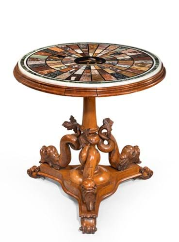 A Regency specimen marble table, on a base carved with Dolphins.jpg