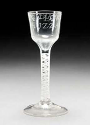 Glass with double series opaque twist to the stem sold at Sotheby's